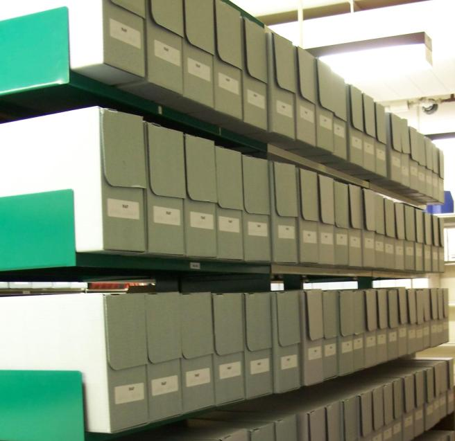 Archives in boxes on shelves